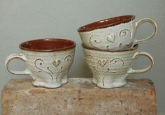 Romantic stoneware coffee cup, white and rust red with heart. kr190.00, via Etsy.