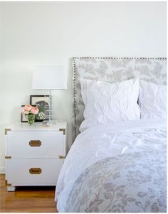 How peaceful! Love love the campaign side table, lamp, and flowers! And the bedding (I have the duvet!)