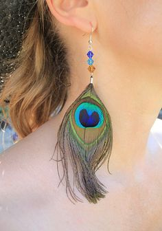 Sapphire Blue and Turquoise Peacock Feather Earrings with Gorgeous Glass Bicone Beads. £6.00, via Etsy.