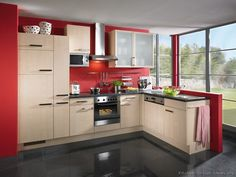 #Kitchen Idea of the Day: Modern Light Wood Kitchen with RED walls, great exterior view. (By ALNO, AG)