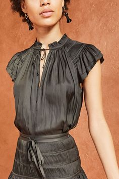 Ruffled satin blouse with intricate plissé pleating. Tiered flutter sleeve, split neck with ties, straight silhouette, unlined. COMPOSITION Polyester FIT Model is and wearing size 2 CARE Dry clean Ella Moss, Ulla Johnson, Flutter Sleeve, Everyday Fashion, Fitness Models, Cold Shoulder Dress, Ruffle Blouse, Fashion Outfits, How To Wear