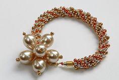 3 colour kumihimo bracelet.  I don't like the beads on the end!