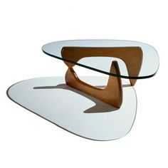 Isamu Noguchi Noguchi Table - The perfect balance—literally—between art and furniture. Sculptor Isamu Noguchi created his distinctive table by joining a curved, solid wood base with a freeform glass top.