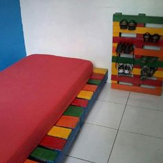 Up-cycle old pallets into bed and a show holder. Great for small boys rooms, or dorm!