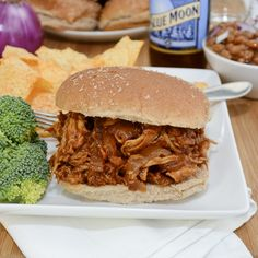 I would love to try this with pork, too.  We used Jack Daniels original BBQ sauce.  Barbecued Pulled Chicken Sandwiches