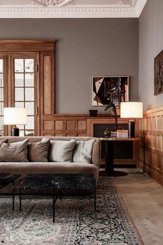 Interior decor trend 2018. Wall panel, wood, black marble table, velvet. Scandinavian decor. Photo: Gubi