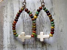Vintaj Brass ear wires dangling with... ~Czech Picasso Seed Beads ~Magnesite White Crosses Measures 2 inches #earrings #ticktock