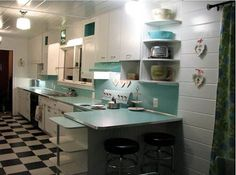 Awesome aqua retro kitchen. Notice the Dishmaster Faucet! www.dishmasterfaucet.com