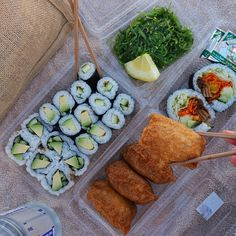 Veggie roll, inari, avocado roll, cucumber roll, avo-cucumber roll and seaweed salad