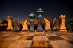 The Bourbon Barrel Chess Set here from the HungarianWorkshop on Etsy is made of 100% used and reclaimed barrels. About as eco friendly a game as you'll ever play. And very beautiful too!