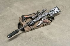 Spartan Precision .300 Win Mag sniper rifle with an Erathr3 Messenger bag and…