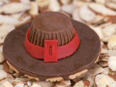 Pilgrim Hats ... fudge striped cookies, mini peanut butter cup, fruit roll-up, chocolate icing as glue