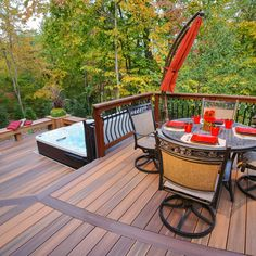 This curved deck is tucked into the woods for lots of privacy. It feature a main deck area and a lower deck dedicated for the hot tub. Skirting is around the main deck and here Fiberon composite decking is used run vertical. Hot Tub Pergola, Hot Tub Deck, Hot Tub Backyard, Pvc Decking, Plastic Decking, Composite Decking, Decking Area, Outside Living, Outdoor Living