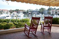 red rocking chairs at the marina