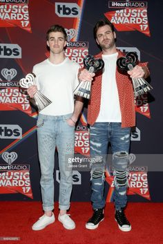 Recording artists Andrew Taggart (L) and Alex Pall of music group The Chainsmokers, winners of the Best New Artist award, Dance Song of the Year award for 'Closer,' and Best New Pop Artist award, pose in the press room at the 2017 iHeartRadio Music Awards which broadcast live on Turner's TBS, TNT, and truTV at The Forum on March 5, 2017 in Inglewood, California.