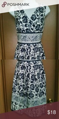Chadwicks blue and white floral dress Sweet floral dress. Beautiful on! Small mark on inside of top, cannot be seen from outside. Perfect dress for Spring! Chadwicks Dresses Midi
