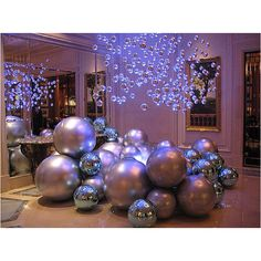 Giant ornaments.. I'm gonna spray paint big bouncy balls to look like ornaments!