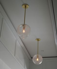 """Single pendant in brushed brass with 9"""" white cane globe with incandescent bulbs"""