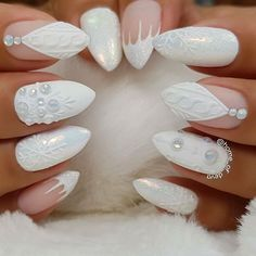White Christmas nails, almond shape, short set, white matte sweater design, snowflakes, rhinestones. Gorgeous! Beautiful nails by Ugly Duckling family members and Exclusive Ambassadors @home_of_deva - Snowflakes are kisses from Heaven ❄️ (the sweater french-ish nails are an adaption of my friend's work @alinah