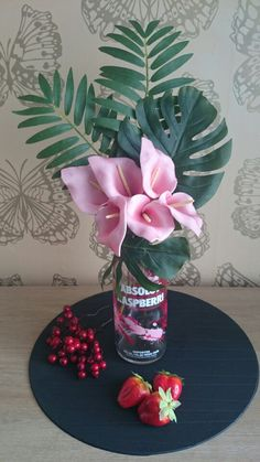 Imitation design i did by recycling a absolute vodka bottle. THE FLORAL EMPORIUM. SOLD