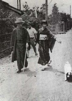 Japanese writer Yasunari Kawabata walking with his wife Hideko and his dog, Asakusa, Tokyo - 1928-29. Literary dogs