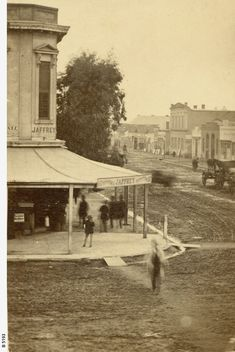 , South corner of King William St. Photograph shows the Jaffery Building on the corner. There are ramps over the gutter and the streets look very muddy. A horse and cart travel along King William Street. (Susan and David married in Williams Street, King William, Street Look, Acre, Corner, Photograph, England, Daughter, David