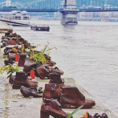 The #Shoes on the #danube Bank is a memorial in #Budapest , #Hungary . Conceived by film director Can Togay, he created it on the east bank of the #danuberiver with sculptor Gyula Pauer to honor the people who were killed by fascist Arrow Cross militiamen in Budapest during #worldwar II. They were ordered to take off their shoes, and were shot at the edge of the #water so that their bodies fell into the #river and were carried away. It represents their shoes left behind on the bank.