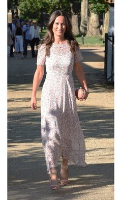 Before news of her engagement broke, the bride-to-be stunned at the Frost Family Summer Party wearing a pink daisy print chiffon dress by L.K. Bennett that she paired with nude sandals and a studded clutch bag.
