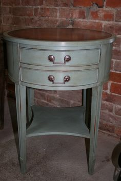 Chalk Paint® decorative paint. Duck Egg Blue with dark and clear wax.  Table top leather.