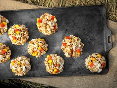 Candy Corn Popcorn Balls from FoodNetwork - might try a deconstructed version to cut back on sugar & effort by just making a Halloween trail mix with these ingredients instead ... popcorn, candy corn, peanuts, marshmallows.