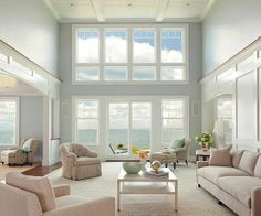Like the window wall, ceiling detail, and columns. The height of the paneling molding on the walls brings the room into a more human scale without taking away from that view
