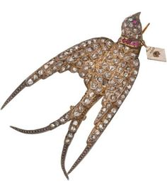 """Georgian Diamond, Ruby, Silver-Topped Gold Brooch. The brooch, designed as a swallow, features rose-cut diamonds weighing a total of approximately 1.55 carats, accented by round-shaped rubies weighing a total of approximately 0.10 carat, set in silver-topped 10k gold, completed by a pinstem and """"C"""" clasp."""