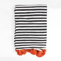A fabulously bohemian Moroccan Pom Pom Blanket.For our free gift wrapping service please add this at the checkout. Available in 2 sizes: Medium Large Pom Pom Colour options: Orange Red Blue GreenOur 100% Cotton Stripe Pom Pom Blanket is handmade in monochrome black and white stripes and embellished with vibrant coloured cotton pom poms. Handwoven on wooden looms in Morocco, these traditional Berber designs are adapted by Bohemia to create a contemporary home accessory, perfect as a throw or…