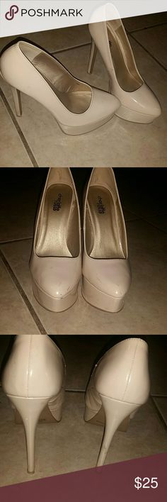 Nude platform pumps high heels stilettos Lightly USED  Nude platform pumps high heels stilettos  Nude Beige  SUPER COMFORTABLE ! Size 7  Minor wear as shown in pictures they still look fabulous! Charlotte Russe Shoes Platforms