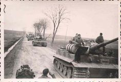 a Group of Tiger Tanks on the retreat in Russia with fuel barrels