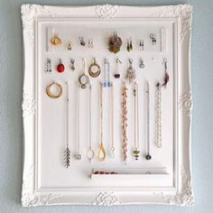 Pretty frame painted white make a great jewelry display