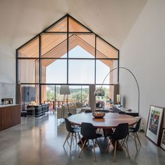 Dining Table House in Ourém by Filipe Saraiva – Arquitectos Dining Room Design, Dining Room Table, Arco Floor Lamp, Steel Doors And Windows, Modern Barn House, Interior Architecture, Interior Design, House Design, Loft Design