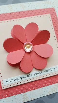 Heart punched flower on embossed paper