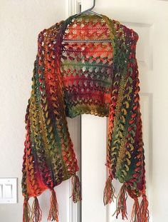 A crochet pattern for this light weight, airy shawl, worked up in the hairpin lace technique. Perfect for summer nights