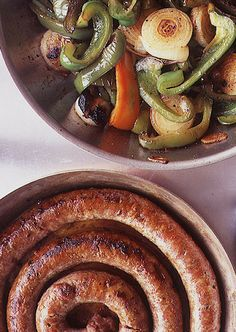 Sausage with Peppers and Onions by Saveur. We love Italian sausage piled high with peppers and onions on a hard roll.