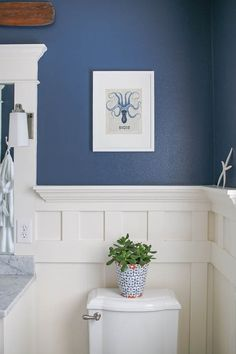 Pretty and fresh navy and white coastal inspired bathroom. Finished with carrara marble and board and batten wainscoting. Pretty and fresh navy and white coastal inspired bathroom. Finished with carrara marble and board and batten wainscoting. Blue White Bathrooms, White Bathroom Decor, Bathroom Colors, Bathroom Interior, Blue Bathroom Paint, Bathroom Ideas, Gold Bathroom, Cream Bathroom, Neutral Bathroom