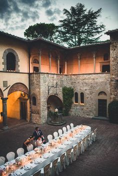 Erin and Trevor's  beautiful courtyard reception for their guests at the Castello il Palagio.. See more beautiful photos by Francesco Spighi here @intimatewedding #reception #longtables