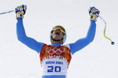 Mayer beats Miller, Svindal in Olympic downhill - Italy's Christof Innerhofer celebrates after finishing the men's downhill at the Sochi 2014 Winter Olympics, Sunday, Feb. 9, 2014, in Krasnaya Polyana, Russia. (AP Photo/Christophe Ena)