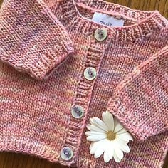 This easy-to-knit baby cardigan is knit from the bottom up in one piece.
