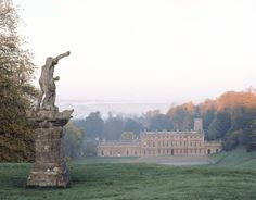 View of Dyrham Park from the entrance drive, with Claude David's statue of Neptune, acquired by William Blathwayt for his baroque garden. ©National Trust Images/Rupert Truman