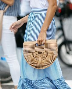 A smaller straw bag creates a more relaxed look for the day. http://www.stylestaples.com.au