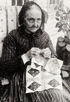 19th century woman handpiecing a quilt.