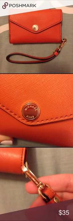 Michael Kors Orange Coin purse card clutch pouch Very clean. Small little scratched on MK logo showed in second picture. The phone holder on the inside was cut out however the pouch is functional as a coin purse and card holder or money holder. Some little tears around edges seen in last pic. Overall looks good MICHAEL Michael Kors Bags Clutches & Wristlets
