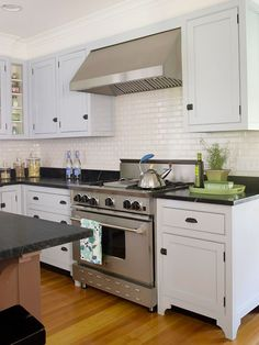 Mix Modern Convenience with Classic Style.  I love the black counters and classic white cupboards with stainless steal!