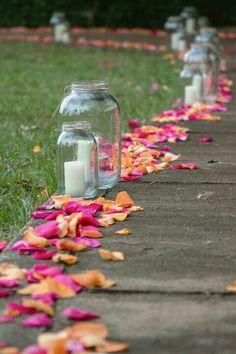 Make a pathway of petals with rose petals from www.petalgarden.com